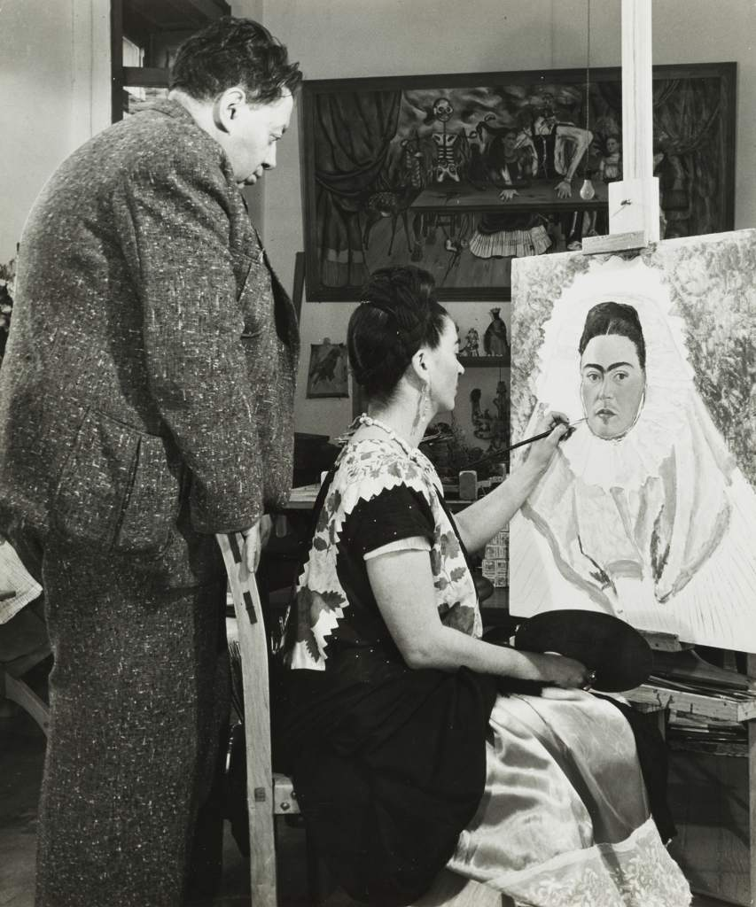 United States, Diego Rivera Watching Frida Kahlo Paint a Self Portrait, circa 1940