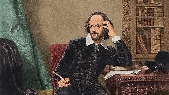 immagine di William Shakespeare seduto alla scrivania