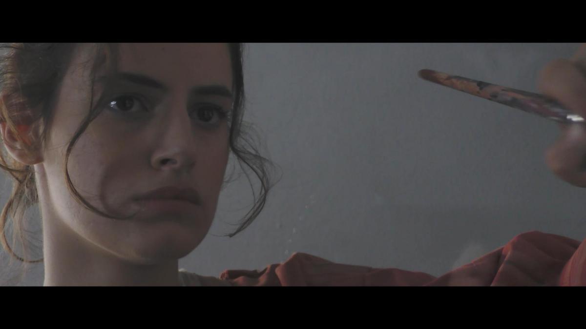 Artemisia Gentileschi mentre disegna nel film